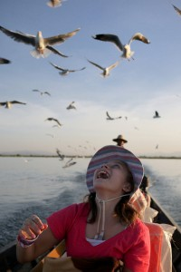 Feeding birds Inle Lake Burma